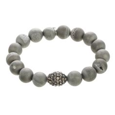 Classic and contemporary at the same time, our 10 mm Silver Druzy Beaded Bracelets are accented by a Pave Crystal Bead.  Druzy beads are partially open stones reveling sparkling crystals which unfold like a secret. Though the outside of the stone is a matte finish, it has a sheen that sparkles in the light.  Druzy stones are believed to make the body's natural healing properties stronger and strengthen the spirit. The color silver adds glamour and sophistication.