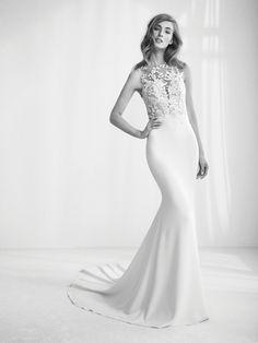 4/38  ATELIER PRONOVIAS 2018  RAIKA REQUEST AN APPOINTMENT FIND A RETAILER ADD TO MY FAVOURITES PRODUCT DETAILS  Crepe Monique and gemstones merge to create this fabulous mermaid style dress, with a two-piece effect joining an accentuated mermaid skirt with train, to a spectacular illusion bodice, which fuses crystal tulle with gemstone embroidery appliqués, both on the bust and back, creating the effect of a very sensual and elegant second skin.                 Blog Newsletter Subscribe to…