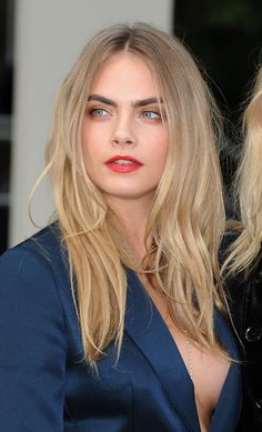 Cara Delevingne posed at the Burberry S/S 15 Show, London Fashion Week