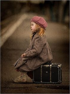 little girl sitting on valise....not sure what to feel but I can see myself in this picture as the little girl waiting, just waiting.........for something.