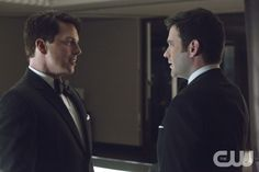 "Arrow -- ""Dead To Rights"" -- Image AR116b_3329b -- Pictured (L-R): John Barrowman as Malcolm Merlyn and Colin Donnell as Tommy Merlyn -- Photo: Jack Rowand/The CW -- © 2013 The CW Network. All Rights Reserved."