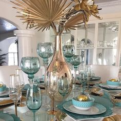 captivating tablescape by takes a cue from our Summer Guide to Color, pairing soothing summer aqua with champagne accents to make a style statement! Tap the link in our bio to shop all the pieces on her table.