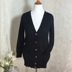 Classic lightweight black cardigan Classic, lightweight, slimming black cardigan sweater. 109% Acrylic, feels more like cotton  Sweaters Cardigans