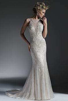 Sottero & Midgley. See more details from Sottero & Midgley��Sultry sheath wedding dress, with intricate patterns of sparkling beading and shimmering Swarovski crystals adorning the bodice and plunging illusion neckline. Finished with open back and crystal buttons over zipper closure.
