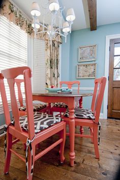 Chairs painted in Sherwin-Williams Coral Reef, 2015 color of the year, pair well with light blue, chocolate brown and white - Lights Online Blog