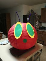 The Very Hungry Caterpillar - Paper Lantern - I used my cricut to cut out yellow and green ovals for the eyes a green circle for the nose/mouth and purple pipe cleaners for the antenna. I will put the rest of the body together when school starts. This will be great in my elementary school library.