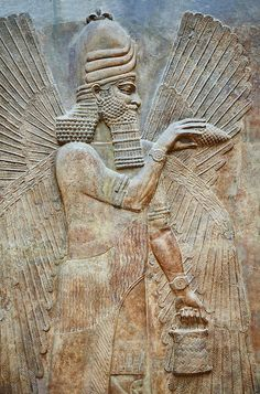 Stone relief sculptured panel of a Genie Blessing. Facade N. Inv AO 19865 from Dur Sharrukin the palace of Assyrian king Sargon II at Khorsabad, 713-706 BC. Louvre Museum Room 4 , Paris | Photos Gallery