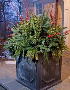 Utilize Summer Planting Pots filling them with cut evergreen, branches and berries. Could also use pine,boxwood, yew, dried hydrangea flowers or seedpods