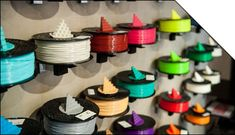 """BUYER'S GUIDE TO FILAMENTS: """" Personal 3D Printer filament buyer's guide for new 3D Printer users.  Every single point presented here is worth a lengthy post, but this should serve as a top-level summary that might help you determine what plastic filaments will best suit your needs."""" > http://www.protoparadigm.com/blog/2012/06/3d-printer-filament-buyers-guide/"""