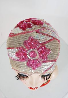 Breathtaking 1920's French baby-pink and opalescent sequin flapper evening headpiece. This is, without a doubt, one of the most extraordinary antique cloche hats I have ever laid eyes on. Hand-beaded sequins with tons of sparkle in the most amazing large scale art-deco floral motif design. Made out of soft net-mesh so it is incredibly comfortable and stays securely on while you dance the night away.