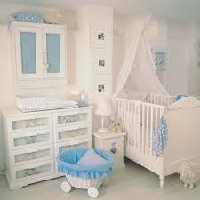 Love the baby blue and white color scheme and cabinet above changing area!