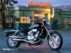 Honda Magna 1998 -- own one of these... 4 pipes/2 per side, buzzsaw wheels, VFR-derived V4 on prominent display -- a very good looking classic.