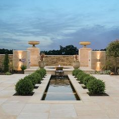 possible setup for the pool. long, wider rectangular with spa lightly elevated falling into the pool.    contemporary landscape by Lapicida Stone Group