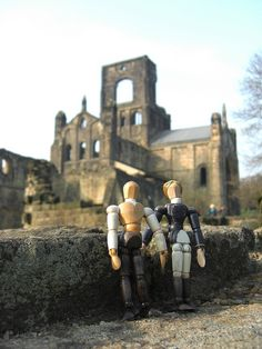 My cousin makes these fictional/historical characters, and takes them on adventures: Poppets in Britain