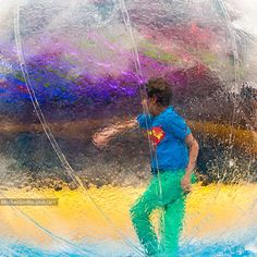 Walking In A Bubble :: Fine Art Street Urban Photography Print for Sale :: By Michel Godts — A child walks inside a giant bubble at the Stockel Town Fair in Brussels, Belgium. #urban #street #fineart #photography #brussels #bruxelles #brussel #photo #foto