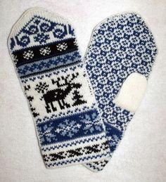 Another pair that I love. Norwegian Scandinavian hand crafted 100% Wool Mittens, folk art, Reindeer from NordicStarStudio via Etsy.