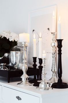 The black glass candle sticks are divine