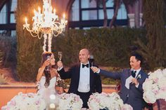 A toast to the bride and groom by the best man.  Stephanie Di Lallo married Justin Oliver at a water front wedding at The Westin Lake Las Vegas.   Las Vegas Wedding Planner Andrea Eppolito  |  Wedding at Lake Las Vegas  | White and Blush and Grey Wedding | Luxury Wedding Las Vegas