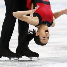Ksenia Stolbova (R) and Fedor Klimov of Russia perform during the pairs free programme at the ISU Grand Prix of Figure Skating Rostelecom Cup in Moscow.