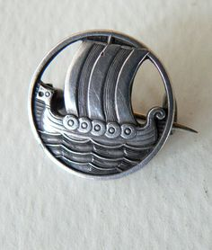 Vintage silver brooch. Danish.Viking ship design. Signed and marke 925. About 3/4 inch in dia.