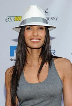 Sexy Clothes and Hairstyles for Tom Boys: Padma Lakshmi uses a classic men's accessory to punch up her casual look.