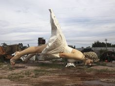 A giant statue of U.S. actress Marilyn Monroe is seen at the dump site of a garbage collecting company in Guigang, Guangxi Zhuang Autonomous...