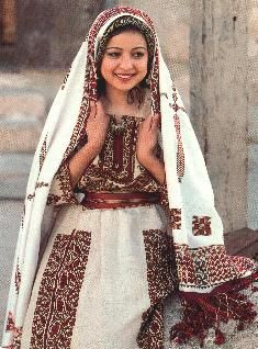 A 1980s UNRWA poster showing a classic Ramallah traditional costume  from the collection of Widad Kawar, Amman (Photo: M Nasr)