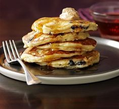 Apple & cranberry pancakes with cinnamon butter & syrup. Would love to try the cinnamon butter.