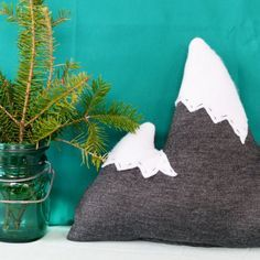 This easy little DIY mountain pillow is the perfect way to add a touch of winter to your kid's room or nursery
