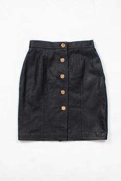 Black Leather Crest Skirt XS/S • Vintage high waisted button up leather pencil mini skirt -- Made in India. This leather mini skirt would pair perfect with a cropped top.