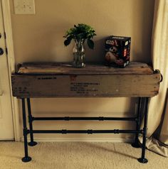 Modern Rustic table :Old Ammo crate, iron pipe, 1 hour and done!