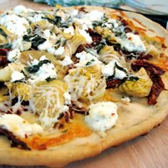 With this recipe, you'll make the garlic and basil pizza dough from scratch, and learn the tricks of grilling a perfect pizza that features tomatoes, olives, roasted red pepper, and basil. Makes two medium pizzas.