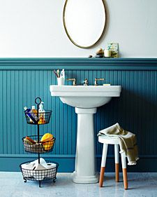 Love the tiered basket idea for small bathrooms!
