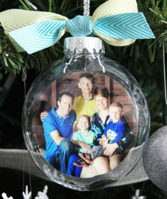 glass photo ornament. I like this circular (probably double sided?) picture inside the bulb instead of trying to modify the picture to fit inside the curvature of the bulb. Although it is probably tricky to get the pic in there without creases.