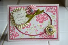 hand crafted card by Aly Dosdall: Anna Griffin Cuttlebug embossing folder ... gorgeous roses ... top layer colored  ... rossette too .. luv it!