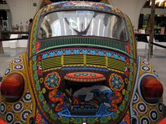 It's called the Vochol, a cross between the word 'vocho',slang in Mexico for the popular Beetle, and the word 'Huichol', theisolated indigenous natives of west central Mexico who spent seven months making it. This beautiful 1990 Volkswagen Beetle was hand decorated by two Huichol families using more than 2 million glass beads and bee's wax to cover every inch of the car's exterior and the dashboard.