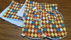 Argyle and Tiny Construction Trucks Print - Set of 2 Bibs & 2 Burp Cloths - Chocolate Brown and Primary Colors.  Preppy and cute combined!