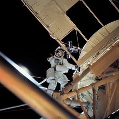 August 1973 - On a spacewalk, astronaut Owen K. Garriott, science pilot, retrieves an imagery experiment from the Apollo Telescope Mount attached to the Skylab in Earth orbit.