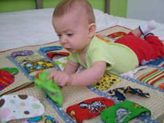 Baby play mat with colorful ears on one side, simple beige on the other side on Etsy, $75.00