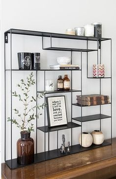 Black color goes with the vintage mirror. Like this one a lot for the divisions and best of all there is space for the P L A N T... Not so wide, only two columns so it can fit in the space.