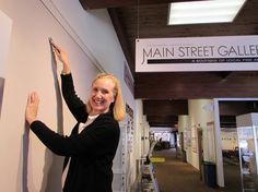 Volunteer Mary Ellen Mueller prepping walls for a new show in Main Street Gallery!