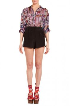 """Silk crepe de chine high waisted shorts with front slash pockets, pleating detail and hook and eye closure. 14"""" rise 2"""" inseam. Zip Fly."""