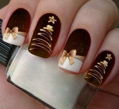 Lovely red & gold festive manicure featuring freehand painted Christmas trees and golden bows #christmasnails...x