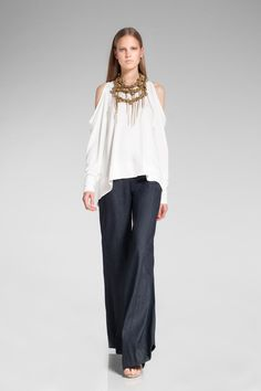 wide-legged slinky pant with a clean white peek-a-boo shoulder blouse topped with a curious necklace. Donna Karan, resort 2014
