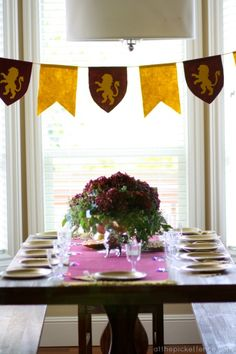 dollar store lion spray painted gold, tiered trays for desserts/food, dollar store items to create floral crown, dollar store goblets