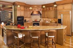 kitchen island idea.  Wonder if we could do a small wrap similar to this to fill in space, yet not take up too much?