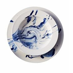 Christopher Spitzmiller's earthenware soup bowl and charger in delft blue and white.