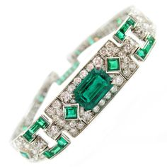 Cartier Art Deco Emerald Diamond Platinum Bracelet --  center emerald weighing approx. 2.4 cts, further set with 40 square and rectangle shaped emeralds, surrounded by 168 Old European cut diamonds