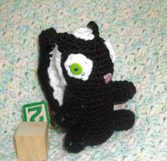 Crochet baby skunk. Perfect for babies and toddlers. $20.00 #shopetsy #homemadetoys