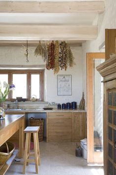 casing around window and beams bring in rustic element/interest for a kitchen with low ceiling